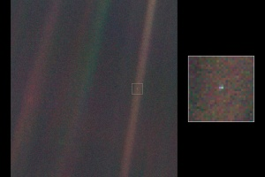 That's us.  A pale blue dot caught in a ray of sunshine.