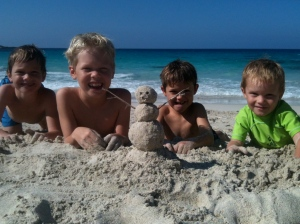 "Building a ""snowman"" on the beach!"